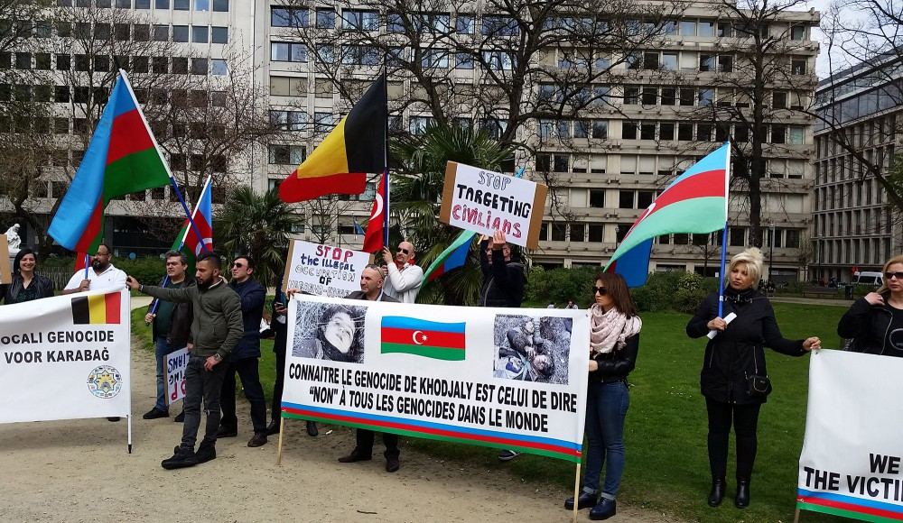 More than 40 Belgian riot police hold back Armenians in Brussels