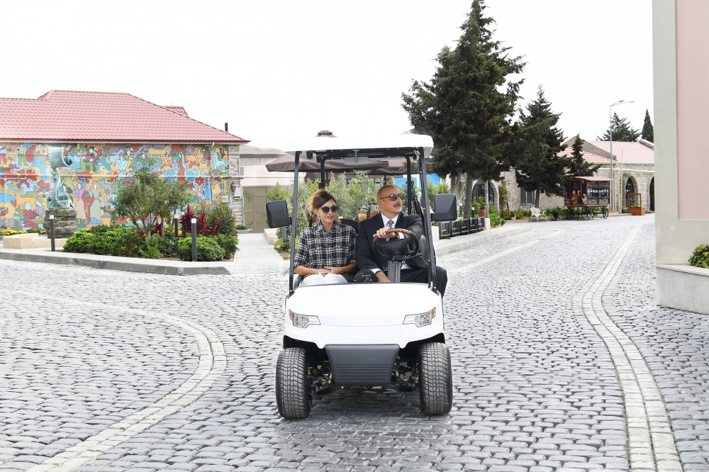 President Ilham Aliyev and first lady Mehriban Aliyeva viewed landscaping work carried out in Balakhani settlement VIDEO
